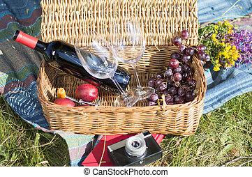 Picnic equipment in a wicker basket