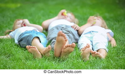 Picnic - Group of happy children playing outdoors in spring...