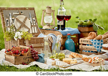 Picnic hamper surrounded by delicious fresh food