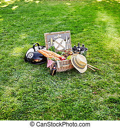 Picnic hamper with fresh vegetables and beer