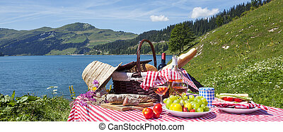Picnic in french alps with lake