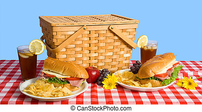 Picnic Lunch - A picnic lunch consisting of a sandwich,...