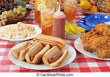 Picnic lunch hot dogs - A picnic table loaded with summer ...