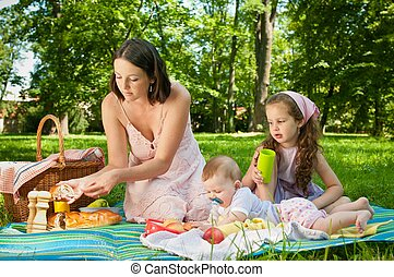 Picnic - mother with children in park
