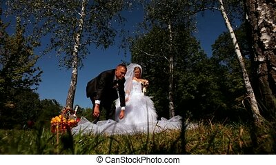 Picnic Newlywed Under The Birch - The bride and groom at a...