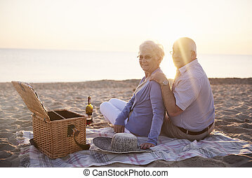 Picnic on the beach on the sunset