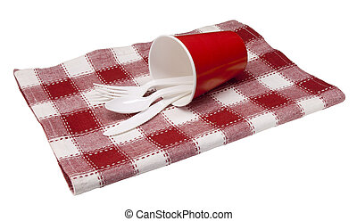 picnic placesetting - plastic tableware in a cup set on a...