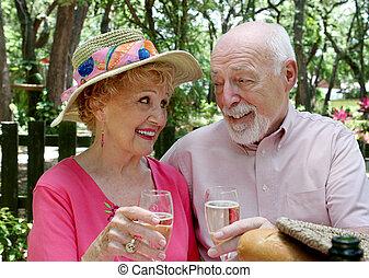 Picnic Seniors - Champagne Toast - An attractive senior...