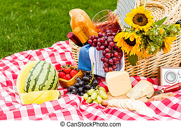 Picnic - Summer picnic with a basket of food in the park.
