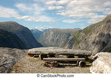 Picnic table on top of a mountain, overlooking a Norwegian...