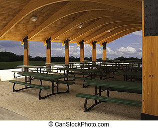 Picnic tables in outdoor pavilion - Green picnic tables...