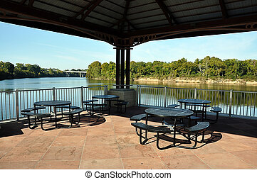 Picnic Tables on Pavilion Overlooking River
