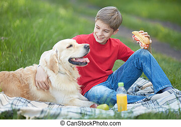 Picnic with dog - Portrait of cute lad and his fluffy friend...