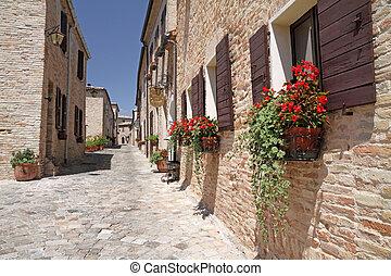 pictorial narrow paved street - in village Montegridolfo in...
