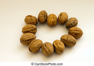circle of walnuts on white background