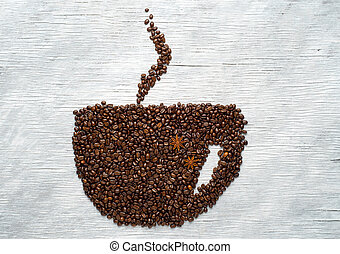 Picture a cup of coffee made from beans on the board