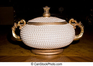 Picture a large white vase