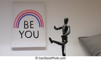 The caption on the picture Be you is a three-lane rainbow. A little toy man in the foreground. Motivating inscription.