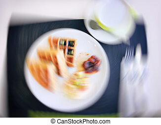 Picture blurred for background abstract. Blur food in restaurant