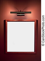 picture frame illuminated by lamp on the wall