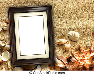 Picture frame on shells and sand background
