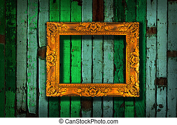 picture frame on vintage green painted wooden wall