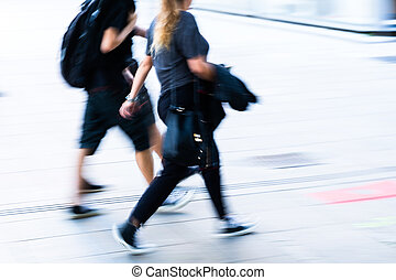 picture in motion blur of people walking in the city