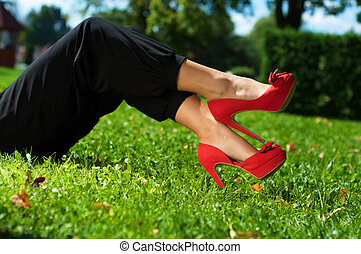 Picture legs of young girl on green grass