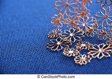 Bijoux necklace on a fabric background - Picture of a Bijoux...