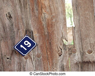 blue plate with house number 19