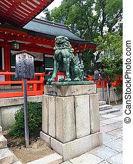 Picture of a bronze Komainu (dog-lion like) statue of the Ikuta Shrine in Kobe City, Japan