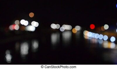 Blurred riverbank lights - Picture of a colorful Blurred...
