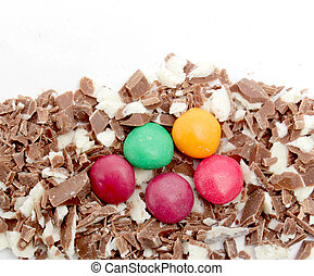 small pieces of a milk chocolate on white background