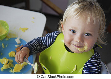 Picture of a cute liitle girl in green bib