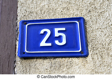 Door numbers on a blue plate