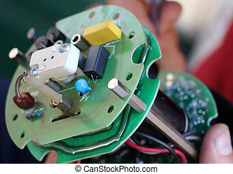 Hands of male fixing electronic device