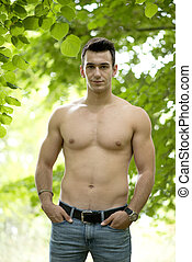 Handsome fit man posing outdoors