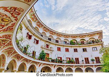 historic building at the Plaza del Cabildo in Seville, Spain