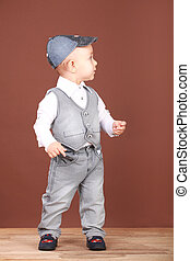 Picture of a little boy in denim suit and a cap