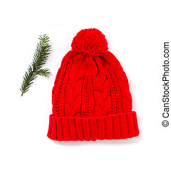 Red knitted wool hat isolated on white