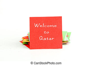 red note paper with text welcome to qatar