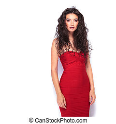 sexy young woman wearing a red dress