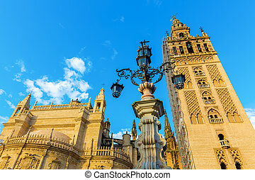 view on the Seville Cathedral from Plaza del Triunfo in Seville, Spain