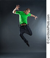 picture of a young dancer, jumping on a energy position