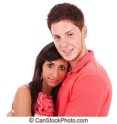 young freckled man holding his girlfriend
