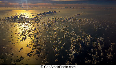 Picture of aerial view over gulf of Thailand at sunset time. flying above the beautiful clouds in the sunset sky.