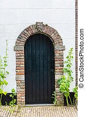 old wooden door in Veere, Netherlands