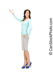attractive businesswoman pointing her hand