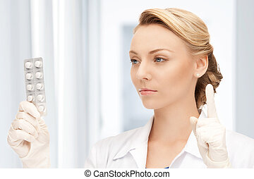 attractive female doctor with pills - picture of attractive...