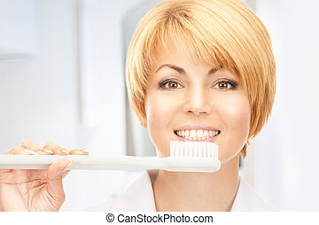 doctor with toothbrush - picture of attractive female doctor...